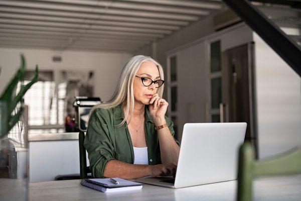 Find-Services-senior-woman-using-laptop